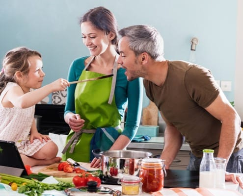 family cooking together at home