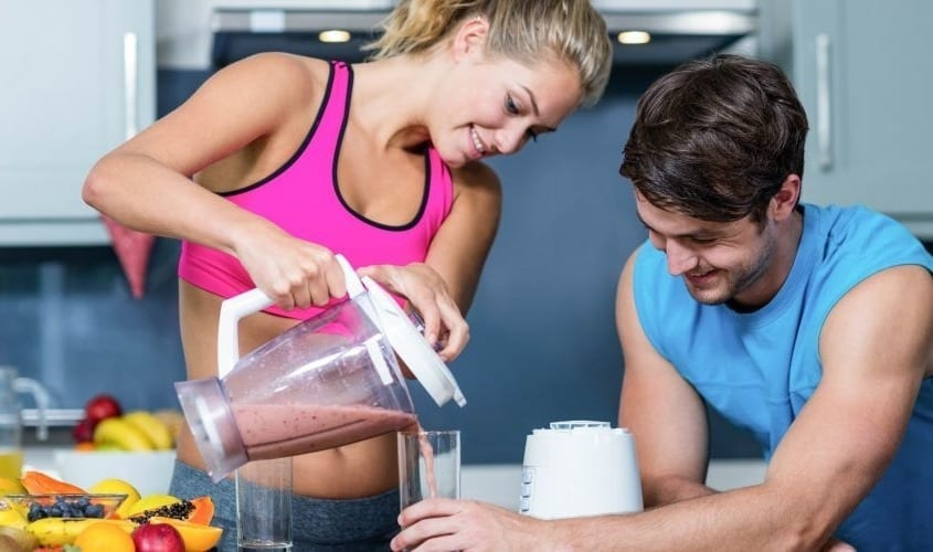 Healthy couple preparing a diet shake