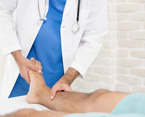 Podiatrist working with patient at vein clinic in Northern Illinois